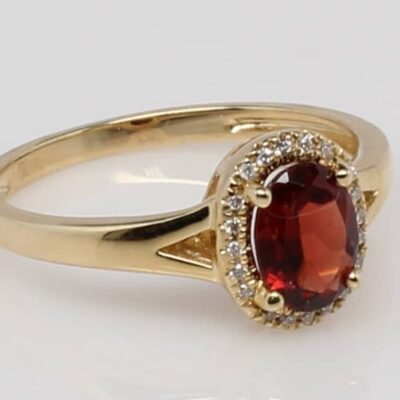 14Karat Yellow Gold Oval Garnet and Diamond Halo Ring