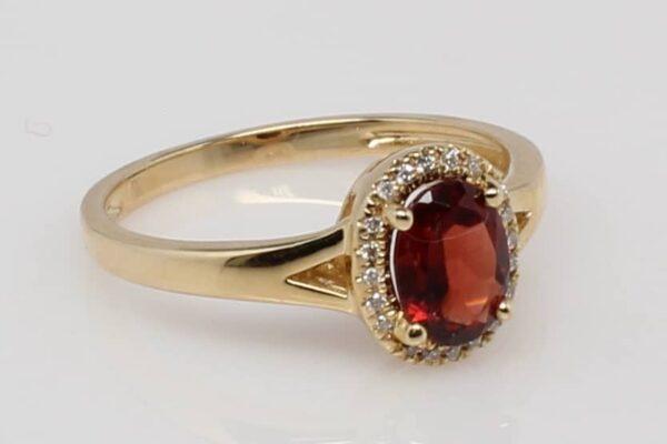 14Karat Yellow Gold Oval Garnet and Diamond Halo Ring