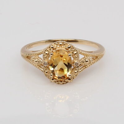 14 Karat Yellow Gold and Oval Citrine Ring with Diamond Accents