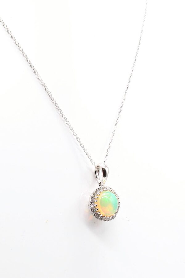 10KW 0.71ct Opal Pendant with Diamond Accents 0.10ctw